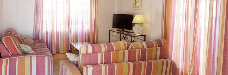 Salón de los apartamentos dunas de doñana 3*